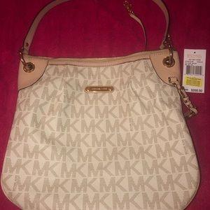 Used MK Bag..... selling as is....